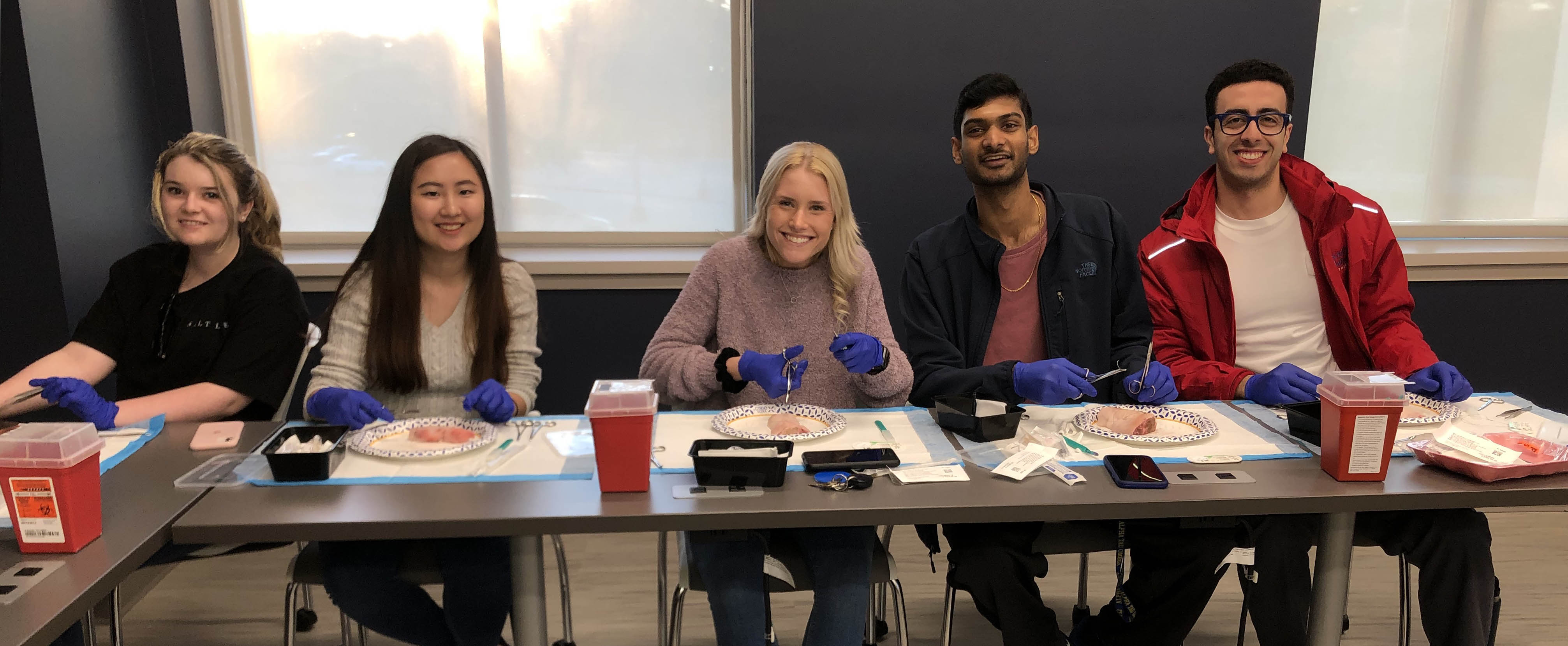 AED 2019-2020 members learning to suture at our spring 2020 suturing clinic