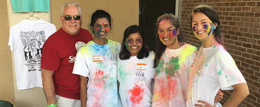 Dr. Carter with Students at Holi Fest