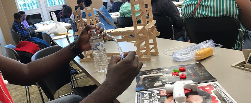 Student building with sticks