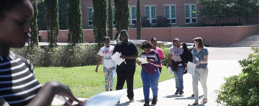 Students walking in front of Shelby Hall.