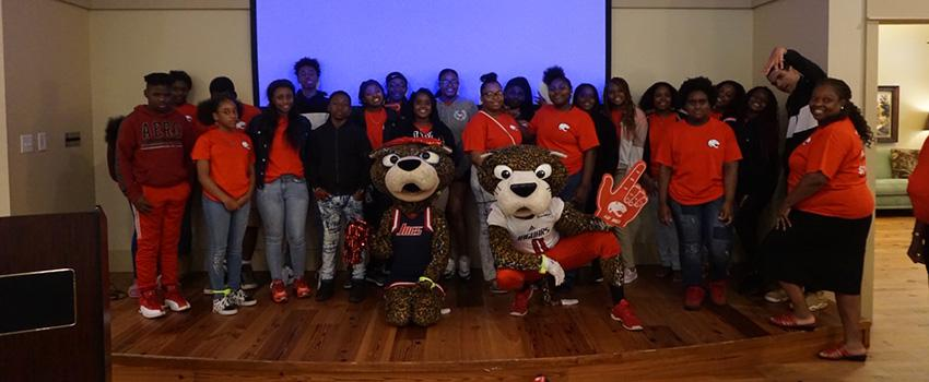Group picture of students with Southpaw and Miss Pawla.