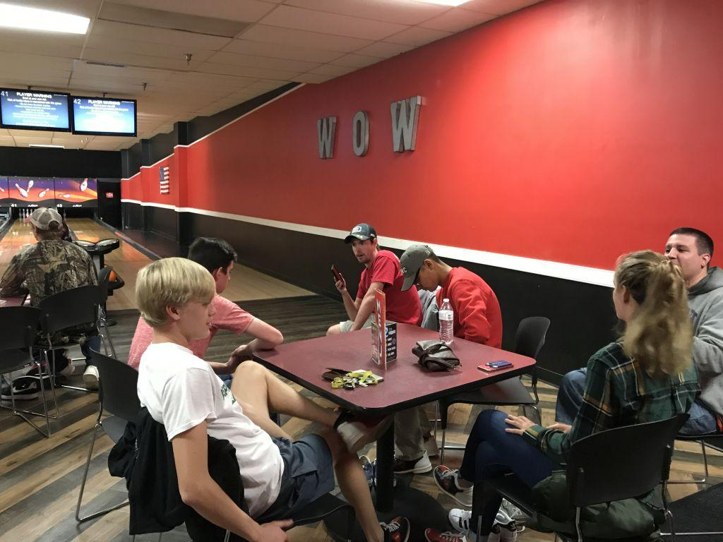 Members of the club attend the monthly bowling social event