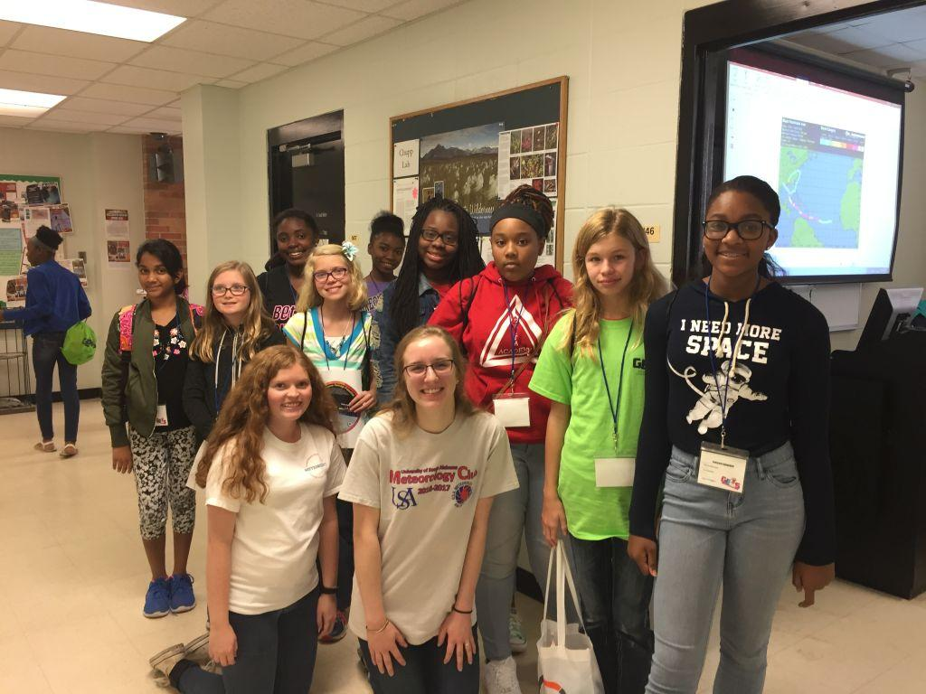 Peyton Barlow, Rebekah Cheatham, and Associate Professor of Meteorology Dr. Lanicci, doing an outreach event with Girls Excelling in Math and Science (GEMS).