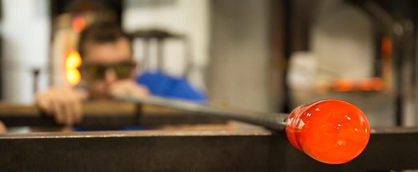 Student working in glass blowing