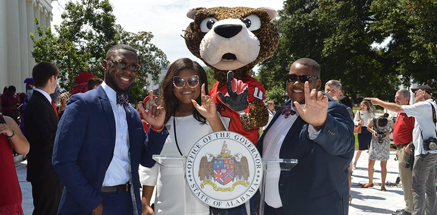 SGA members with Southpaw holding up J hand
