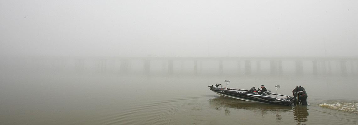 Boat in water with fog
