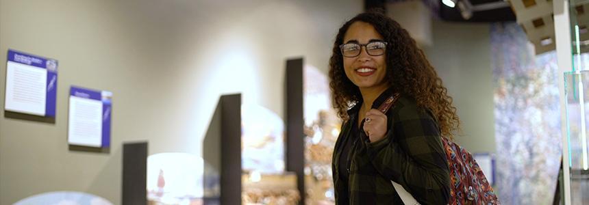 Female student smiling in art room