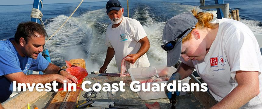 Students working with faculty on boat with fish with Invest in Coast Guardians text overlay