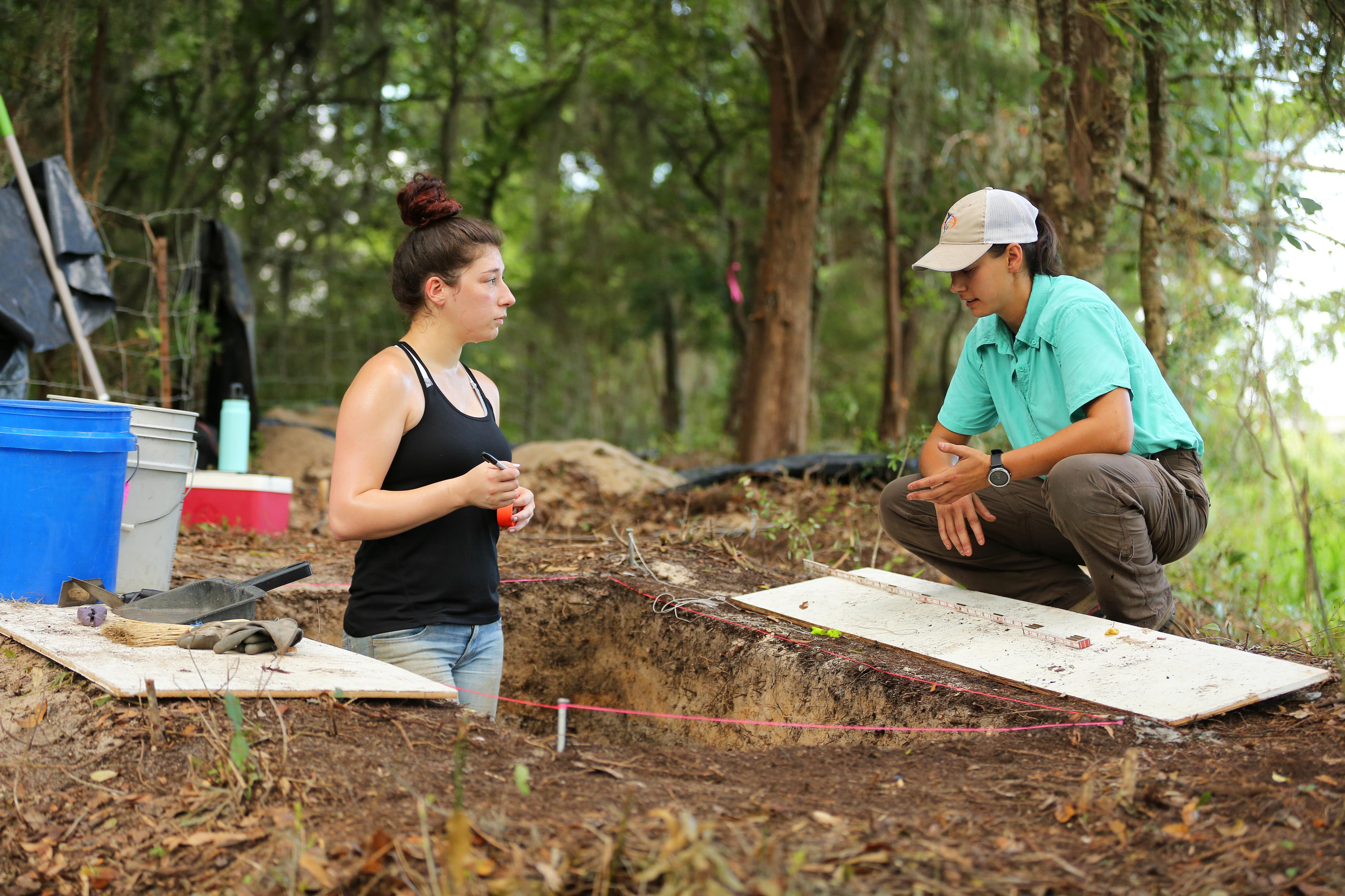 Jordan Temples, who recently earned a bachelor's degree in anthropology from South, talks with Anne Doreland, graduate student and field supervisor.