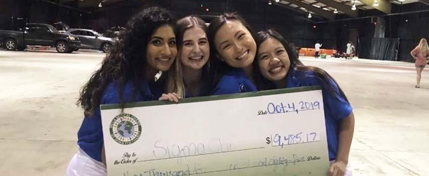 Tanvi Patel, Emily Cleveland, Aly Nguyen, and Christi Nguyen celebrate the amount of money raised at Mega Musical Chairs 2019.