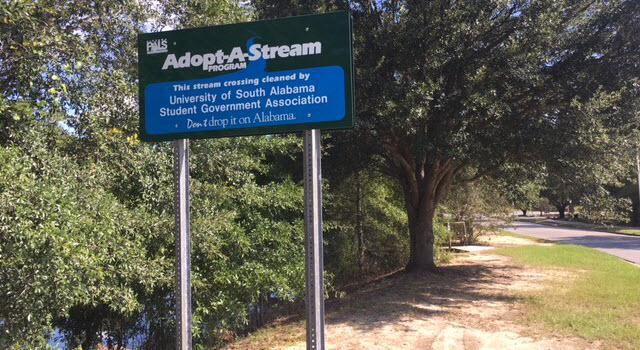 Adopt-A Stream sign placed near the entrance to the Glenn Sebastian Nature Trail by the USA Student Government Association