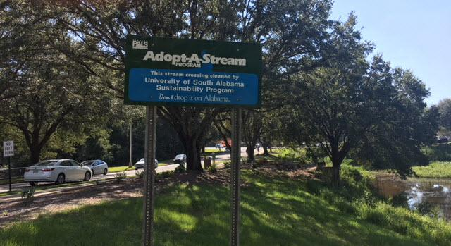Adopt-A-Stream sign placed on Health Services Drive near the spillway