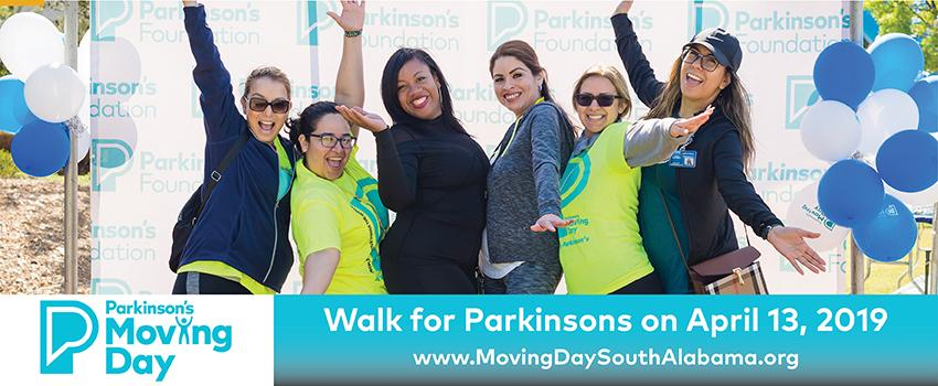 Six females smiling with arms standing in front of Parkinson's Foundation Background