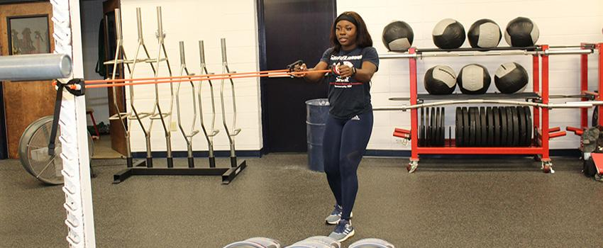 A female student pulling a exercise band