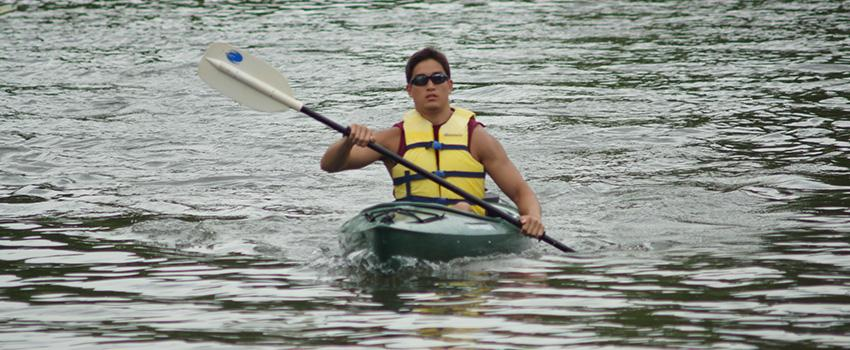 Male student kayaking