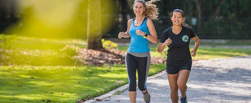 Two female students jogging