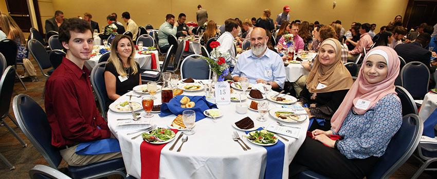 Table of students at scholarship ceremony.