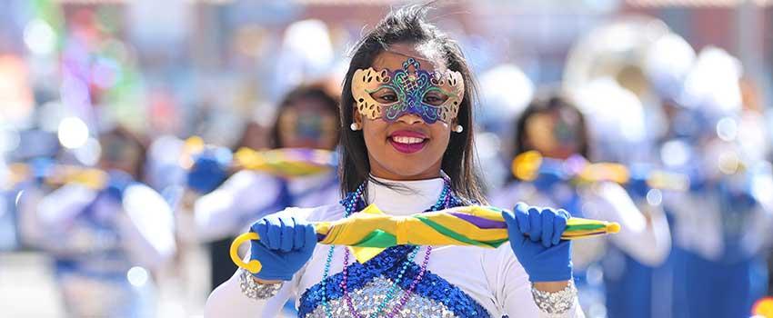 Female in Mardi Gras costume in parade