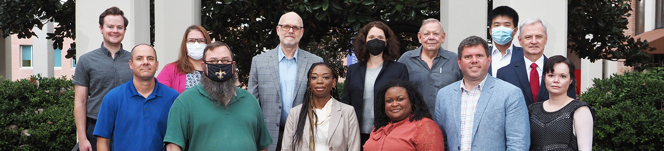 Group image of Political Science and Criminal Justice faculty standing outside.