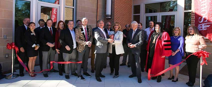 Ribbon Cutting Ceremony in front of Alumni center.