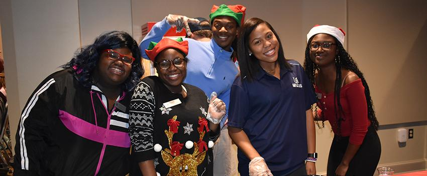 FYC members smile for the camera at a Christmas party