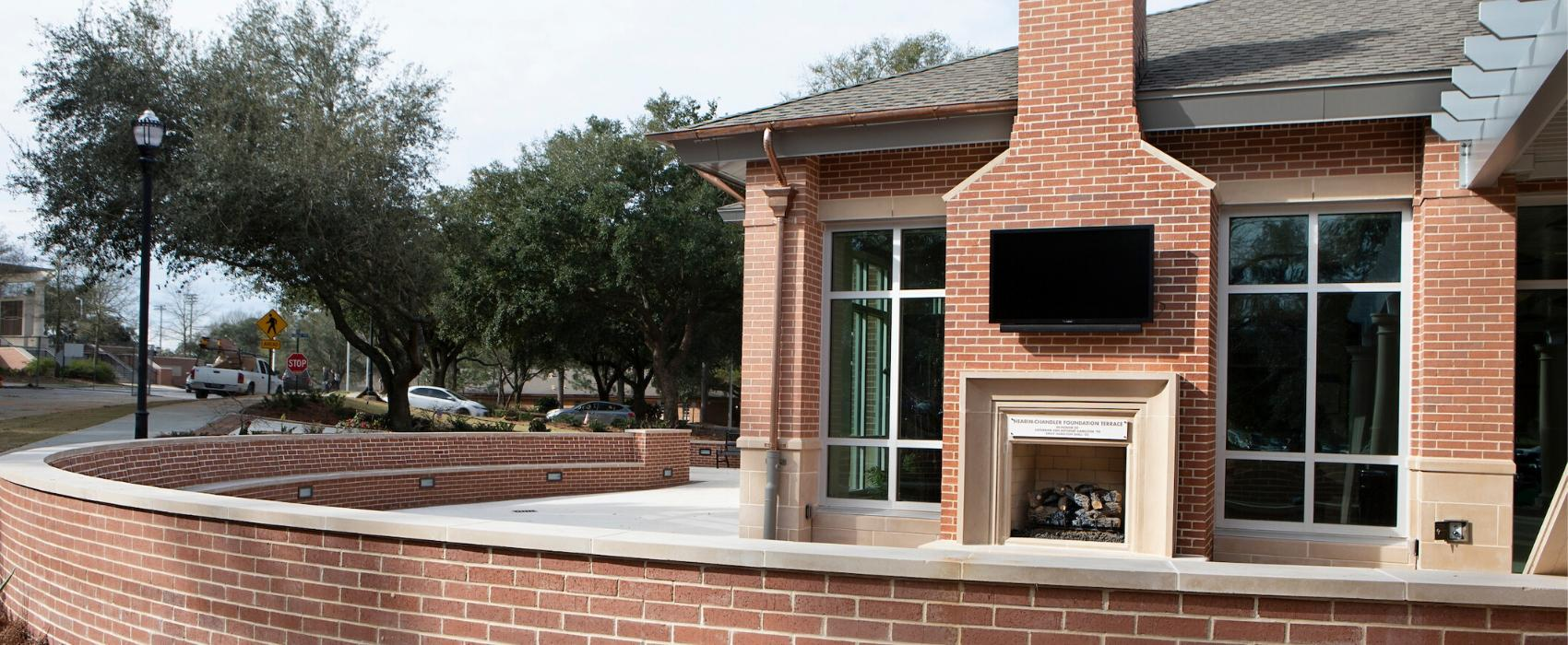 Outside patio with fireplace of MacQueen Center