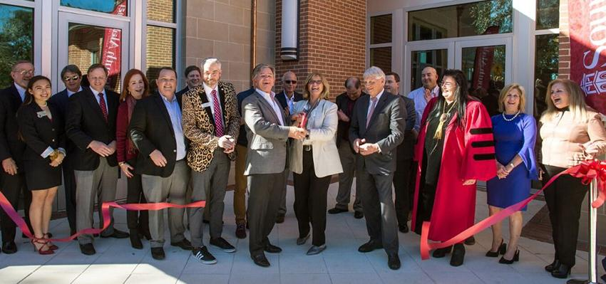 Ribbon cutting for macqueen ceremony