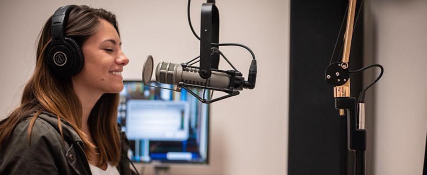 student talking into radio mic