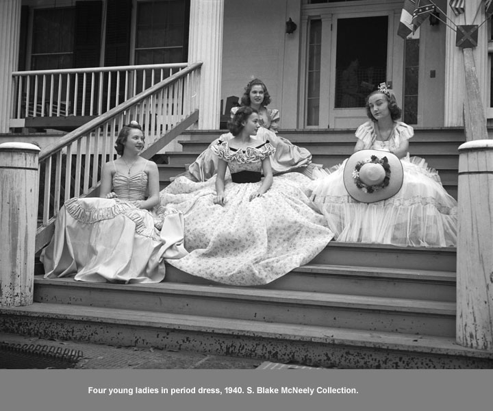 Four ladies dressed in period pieces