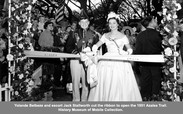 Yolando Betbeze and escort Jack Stallworth cut the ribbon to open the 1951 Azalea Trail.