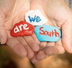 We Are South on painted rocks