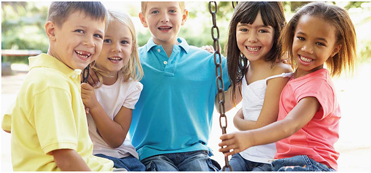 Five young kids sitting on tire swing data-lightbox='featured'