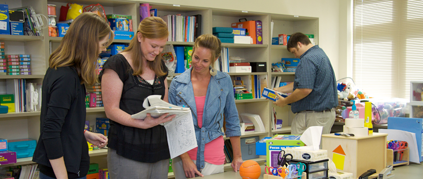SPA students gather therapy materials.