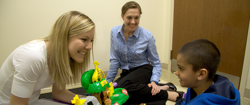 Two speech pathology students in a therapy session.