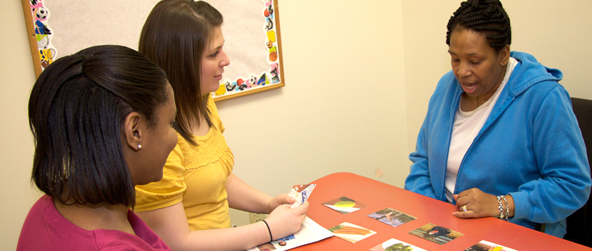 Two speech pathology students in therapy session.