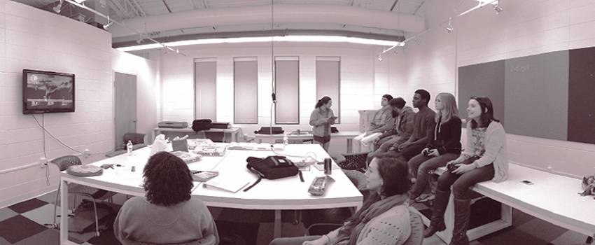 Image of a group critique in a design classroom