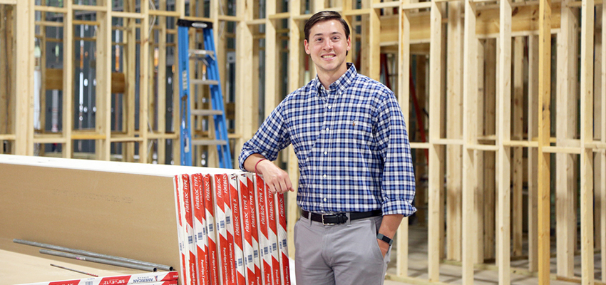 Caleb Santa Cruz, a communication studies graduate, works as a youth pastor at Summit Church, which is constructing a new church building in Foley.