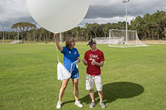 Student working with a weather balloon.