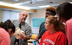 Dr. Phil Carr showing skull in class