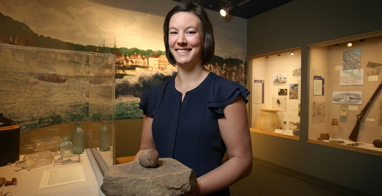Anne Dorland, who is pursuing a master's degree in the College of Education and Professional Studies, teaches archaeology lessons at elementary schools through her graduate assistantship.