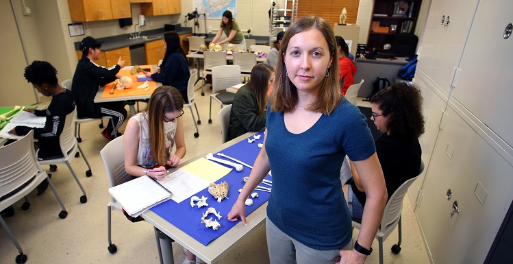 Dr. Lesley Gregoricka, assistant professor of anthropology, enlists the help of students when she does forensic recovery for local law enforcement. Bottom photo: Gregoricka works a case with the Mobile Police Department where human remains were found. Photo courtesy of the Mobile Police Department.