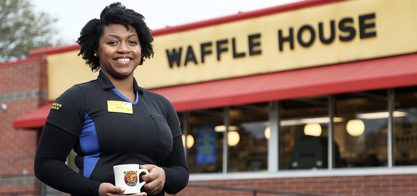 Andrea Kemp in front of Waffle House.