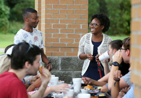 Medical students gather together at the college-wide fall cookout.
