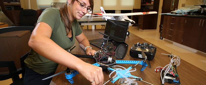 Engineering student working on drone