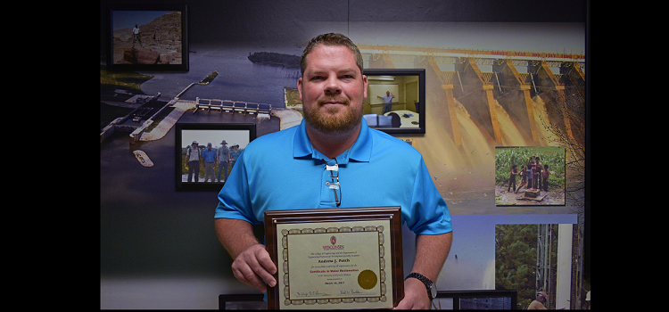 Environmental Engineer Andrew Patch poses for a photo, June 28, with a Certificate in Water Reclamation from the University of Wisconsin-Madison College of Engineering.