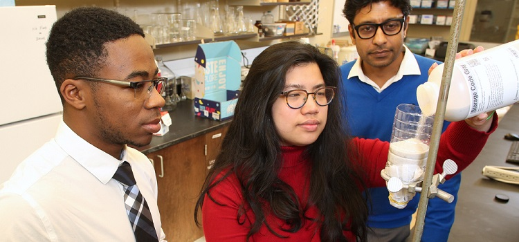 University of South Alabama engineering students Bryant Baldwin, left, and Rachel Chai, center, are creating a filter to adsorb, or adhere, phosphate from wastewater and/or stormwater, under the guidance of Dr. Arka Pandit, an assistant professor of civil, coastal and environmental engineering at USA.
