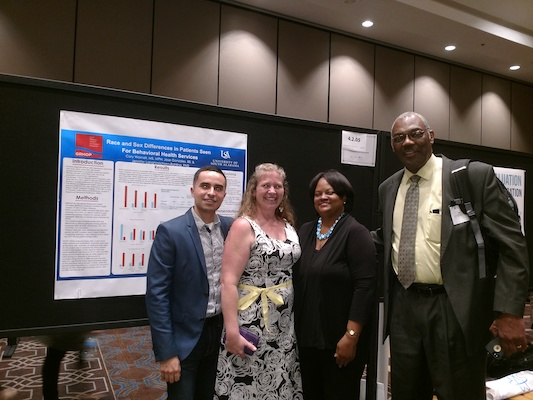 CCP doctoral student Jose Gonzales (far left) with former U.S. Surgeon General Dr. Regina Benjamin (second from right) in front of Jose's and Dr. Jennifer Langhinrichsen-Rohling's conference poster