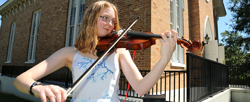 Honors student playing violin