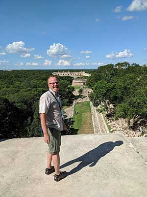 Dr. Doug Marshall in front of ruins in Mexico