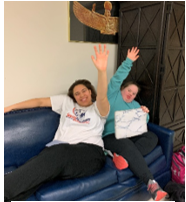 Matysan and Emily raise their hands during a group discussion.